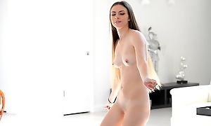 Beautiful young model dances around decidedly naked