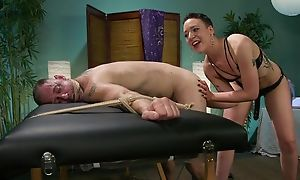 Short-haired mistress with consolidated bosom dominates over her usherette